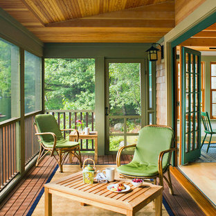This is an example of a small rustic back screened veranda in Boston with a roof extension and decking.