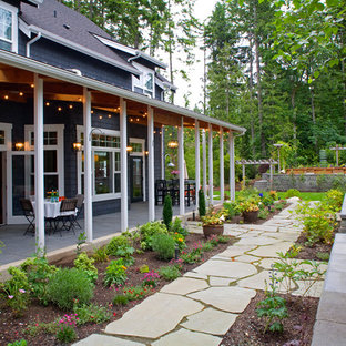 Inspiration for a mid-sized timeless stone porch remodel in Seattle with a roof extension