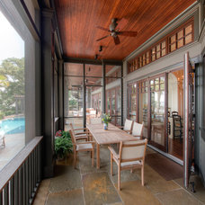 Traditional Porch by Solaris Inc.