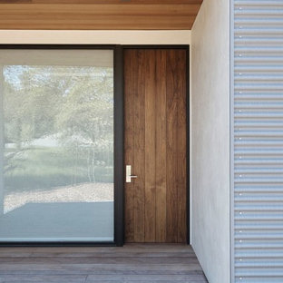 Minimalist porch idea in San Francisco with a roof extension and decking