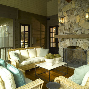 Elegant porch photo in Atlanta with a fire pit, decking and a roof extension