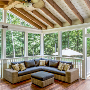 Inspiration for a large traditional backyard screened-in verandah in Charlotte with decking and a roof extension.