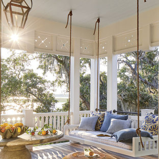 Inspiration for a coastal porch remodel in Jacksonville with decking and a roof extension