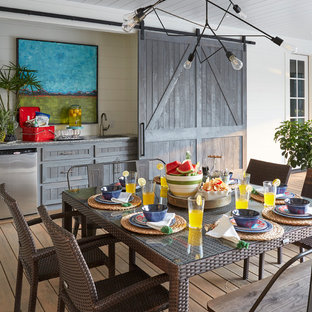 Country outdoor kitchen porch idea in Houston with decking and a roof extension
