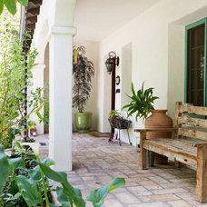 Mediterranean Porch by Charmean Neithart Interiors, LLC.