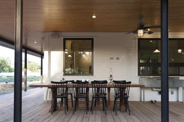 Farmhouse Patio by Risinger Homes