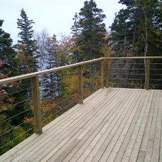 Modern Porch by Stainless Cable & Railing, Inc.