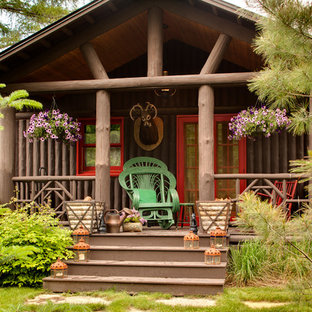 Inspiration for a rustic porch remodel in Milwaukee with a roof extension