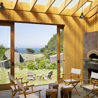 Farmhouse porch idea in San Francisco with a fire pit and a roof extension