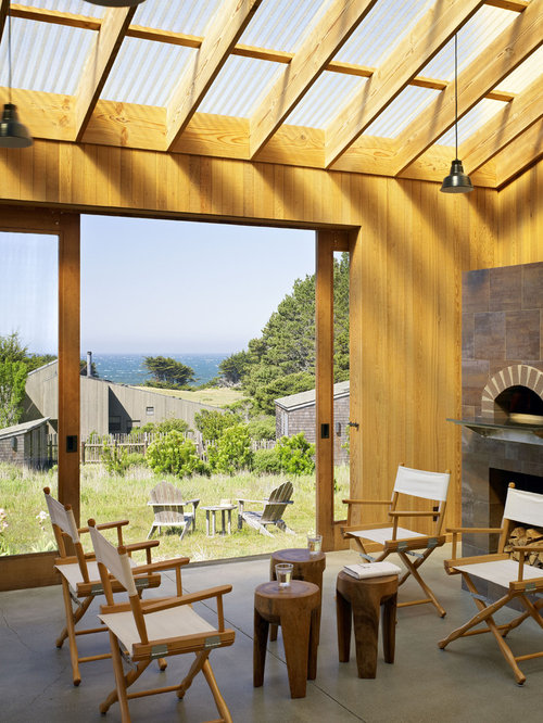 Trendy Porch Idea In San Francisco With A Fire Pit And A Roof Extension