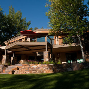 Mid-sized classic stone porch idea in Boise with a roof extension