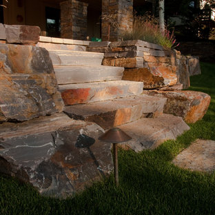 Large elegant stone porch photo in Boise with a roof extension