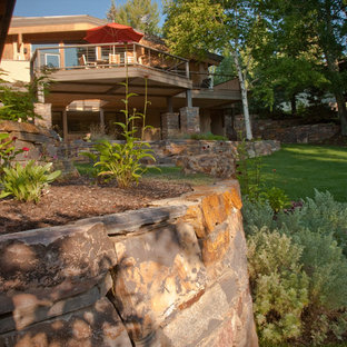 Inspiration for a large timeless stone porch remodel in Boise with a roof extension
