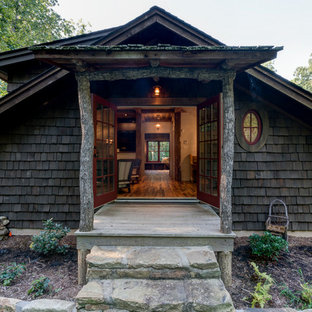 Mid-sized mountain style side porch photo in Other with decking and a roof extension