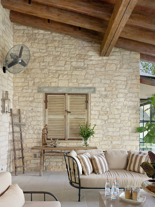 Mediterranean Patio Idea In Austin With A Roof Extension