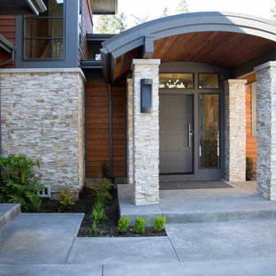 Mid-sized trendy concrete front porch photo in Portland with a roof extension