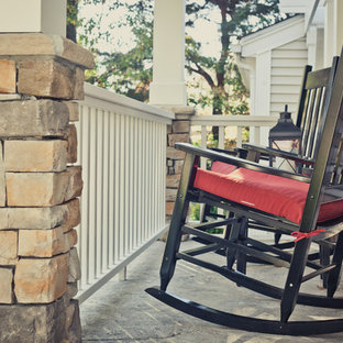 Mid-sized elegant stamped concrete front porch photo in Cincinnati with a roof extension