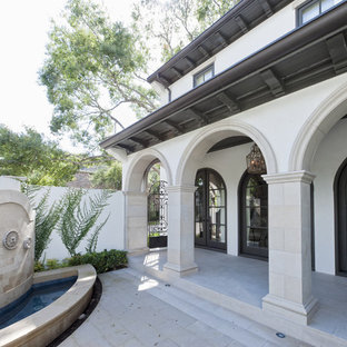 This is an example of a mediterranean porch fountain design in Houston.