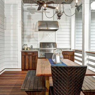 Coastal outdoor kitchen porch photo in Charleston with decking and a roof extension