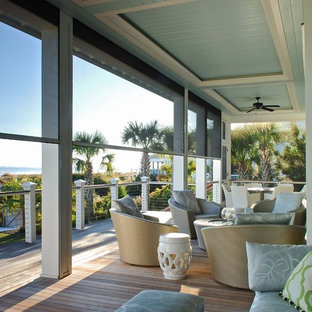 This is an example of a coastal veranda in Charleston with decking and a roof extension.