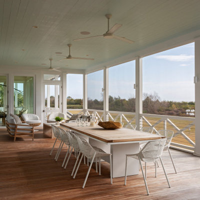 Large beach style back porch photo in Charleston with a roof extension