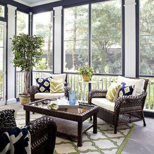 Elegant screened-in porch photo in New York with a roof extension