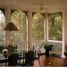 Traditional Porch by Transforming Architecture LLC