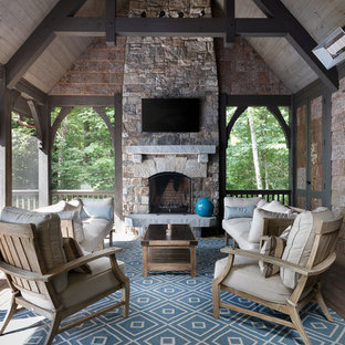 This is an example of a mid-sized rustic porch design in Charlotte.