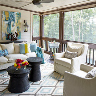Large transitional screened-in back porch idea in Atlanta with decking and a roof extension