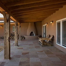 Traditional Porch by Archaeo Architects