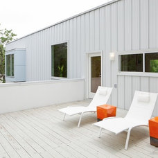Modern Porch by Universal Joint Design Associates