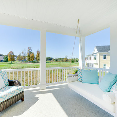 Inspiration for a coastal front porch remodel in Other with a roof extension