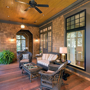 Elegant porch photo in Charleston with decking and a roof extension