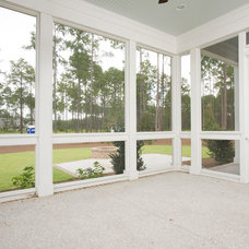 Traditional Porch by Shoreline Construction and Development