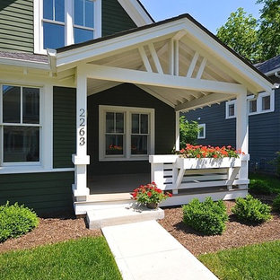 Large arts and crafts front porch photo in Indianapolis with a roof extension
