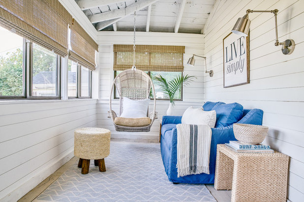 Beach Style Porch by Blakely Interior Design