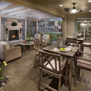 Tuscan porch photo in Denver with a fire pit and a pergola