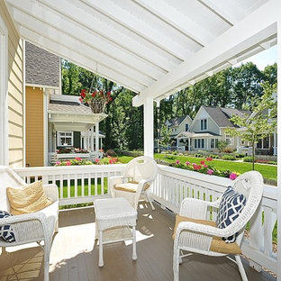 Inspiration for a large craftsman front porch remodel in Indianapolis with a roof extension