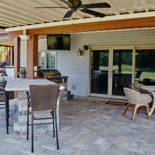 Foto di un ampio patio o portico bohémian dietro casa