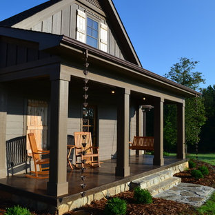 Large elegant concrete porch photo in Charlotte with a roof extension