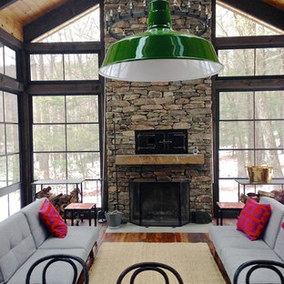 Mid-sized mountain style porch photo in New York