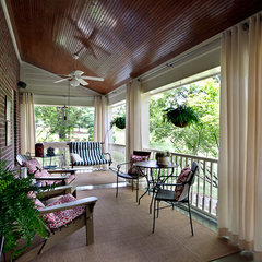eclectic porch by Timeless Interiors, LLC