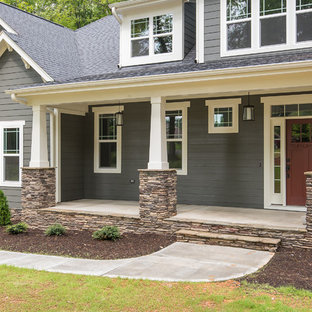 Mid-sized arts and crafts concrete front porch idea in Raleigh with a roof extension