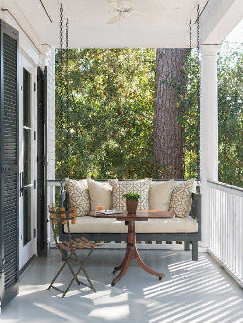 inspiration for a timeless porch remodel in charleston with a roof extension - Front Porch Swing