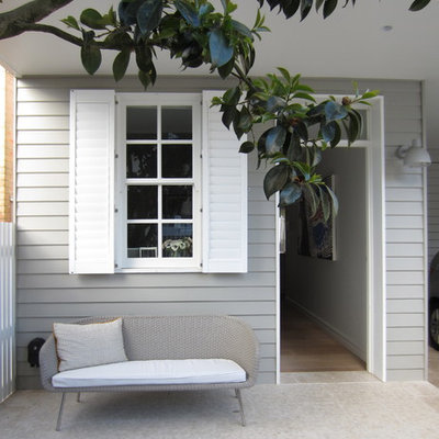 Elegant porch photo in Sydney with a roof extension
