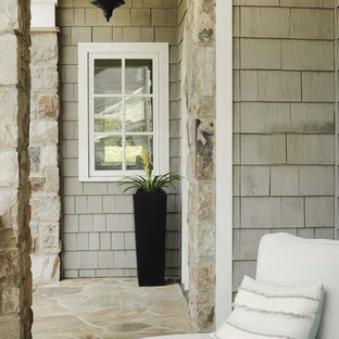This is an example of a traditional porch design in Atlanta with a roof extension.