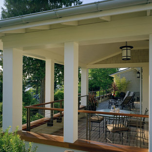 This is an example of a traditional porch design in Seattle with decking and a roof extension.