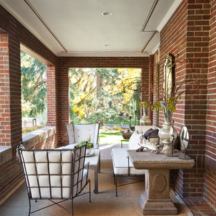 Inspiration for a timeless brick porch remodel in Denver with a roof extension
