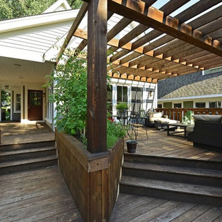 Elegant porch photo in Minneapolis with a pergola