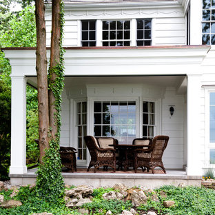 Inspiration for a timeless porch remodel in Toronto with a roof extension